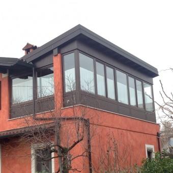 copertura terrazzo  con pareti in legno e finestre